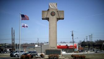 BLADENSBURG, MARYLAND - FEBRUARY 28: A 40-foot cross that honors 49 fallen World War I soldiers from Prince George's County stands at the busy intersection of Bladensberg and Annapolis roads and Baltimore Avenue February 28, 2019 in Bladensburg, Maryland. The cross is at the heart of a Supreme Court case argued by justices Wednesday about whether the symbol runs afoul of the First Amendment's ban on government establishment of religion by sending a message of favoritism to Christianity. (Photo by Chip Somodevilla/Getty Images)