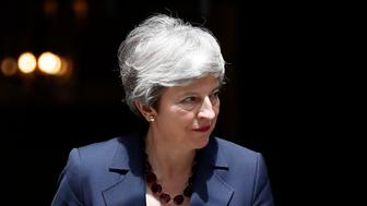 Britain's Prime Minister Theresa May awaits the Prime Minister of Nepal, KP Sharma Oli, to Downing Street in London, Tuesday, June 11, 2019. Britain's Conservative Party is holding an election to replace Prime Minister Theresa May, who resigned last week after failing to lead Britain out of the European Union on schedule. (AP Photo/Frank Augstein)