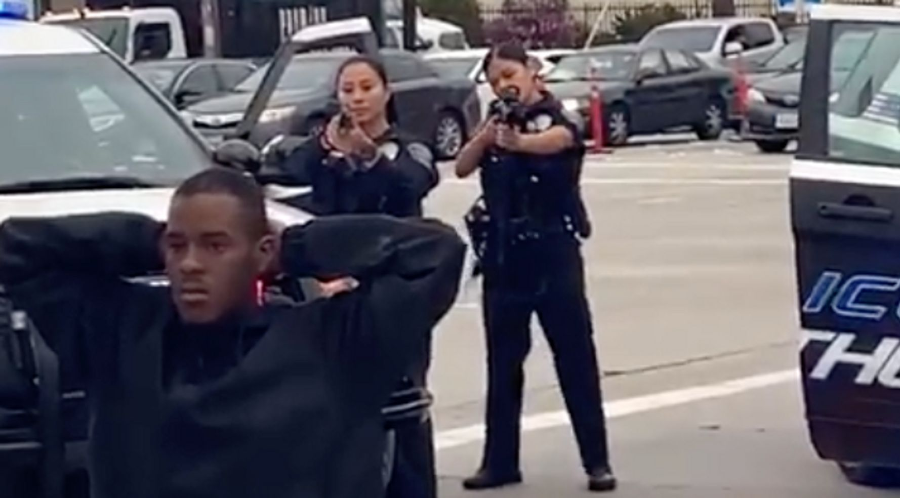 Woman's Video Of Police Aiming Guns At Kneeling Man Goes Viral