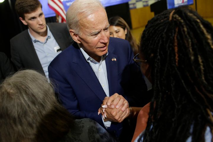Joe Biden greets an attendee during a campaign event Tuesday in Davenport, Iowa.