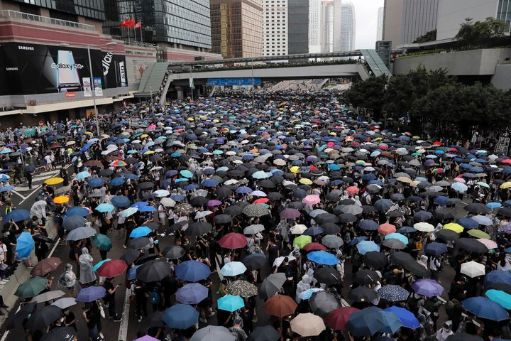Protestors surrounded government headquarters in Hong Kong on Wednesday as the administration prepared to open debate on a hi