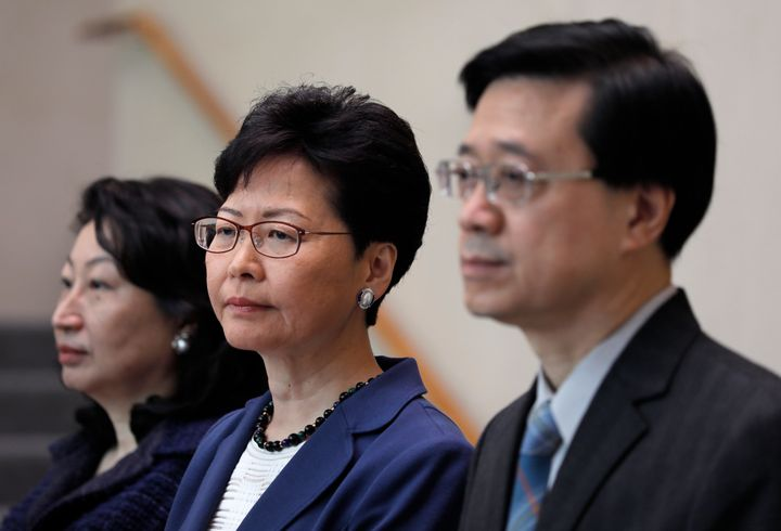 Hong Kong secretary for security John Lee, right, Hong Kong chief executive Carrie Lam, center, and secretary of justice Tere