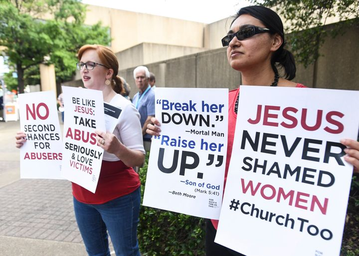 Jennifer Weed, left, and Nisha Virani, both of Birmingham, Ala., demonstrate outside Southern Baptist Convention's annual mee