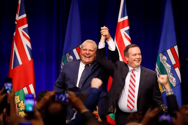 Ontario Premier Doug Ford and Alberta Premier Jason Kenney cheer with supporters at an...