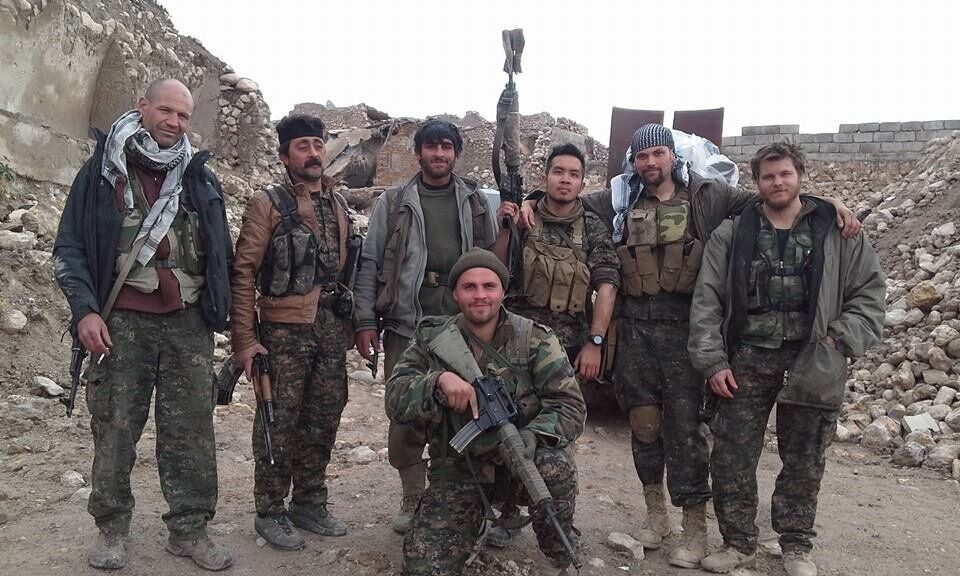 Matthews (left) in Shengal, Iraq. Kosta Scurfield, kneeling, was the first Brit to be killed in action...