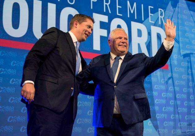 Ontario Premier Doug Ford, right, and Conservative leader Andrew Scheer acknowledge...