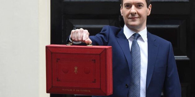LONDON, ENGLAND - JULY 08: The Chancellor of the Exchequer George Osborne holds his ministerial red box...