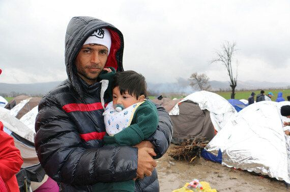 Syrian Children Sleep in the Mud at a Balkan