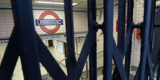 File photo dated 05/08/15 of an Underground sign seen through closed gates at Paddington Underground...