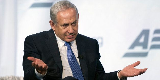 Israeli Prime Minister Benjamin Netanyahu gestures while speaking at the American Enterprise Institute's...