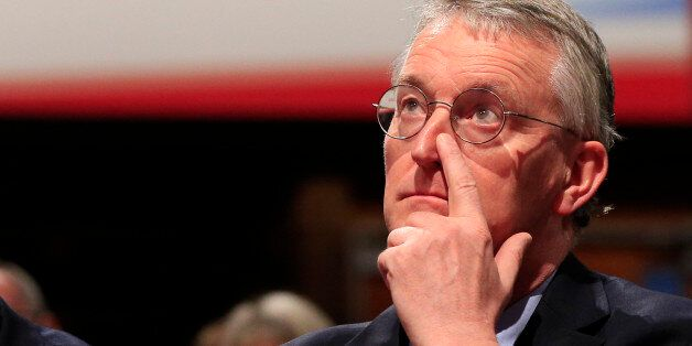 Shadow foreign secretary Hilary Benn watches a debate on the final day of the Labour Party annual conference...