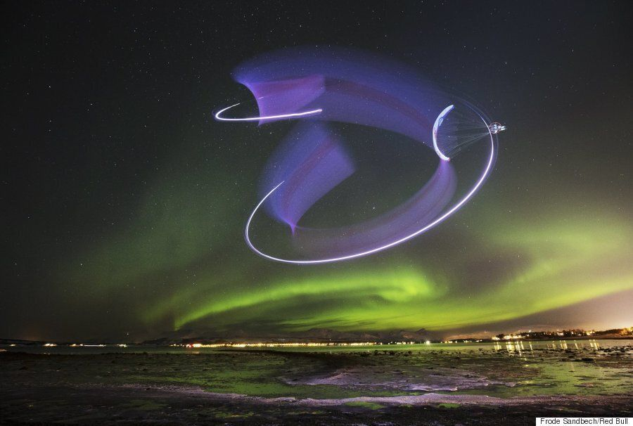 Professional Paraglider 'Dances' With The Northern