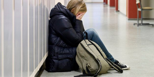 Young woman getting bullied at