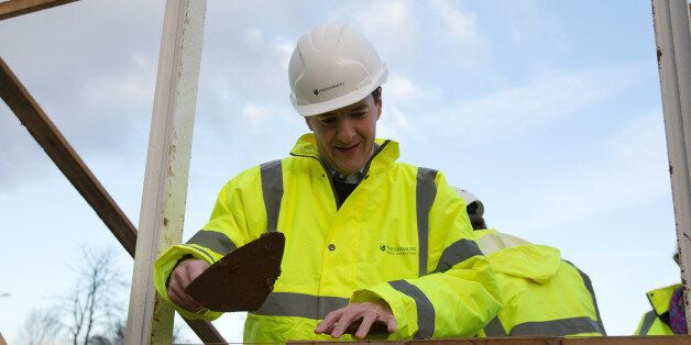 Chancellor of the Exchequer George Osborne lays bricks during a visit to a housing development in South...