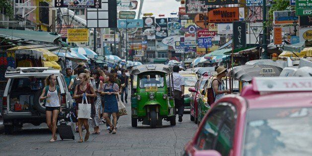 TO GO WITH Thailand-China-unrest-tourism-economy,FOCUS by Preeti JHATourists walk along Khao San road,...