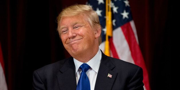 Republican presidential candidate Donald Trump smiles while speaking at a rally at Drake University in...