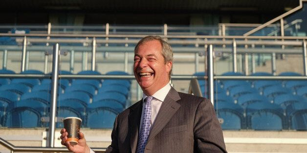 UK Independence Party leader Nigel Farage takes part in a photo call at Doncaster Racecourse at the start...