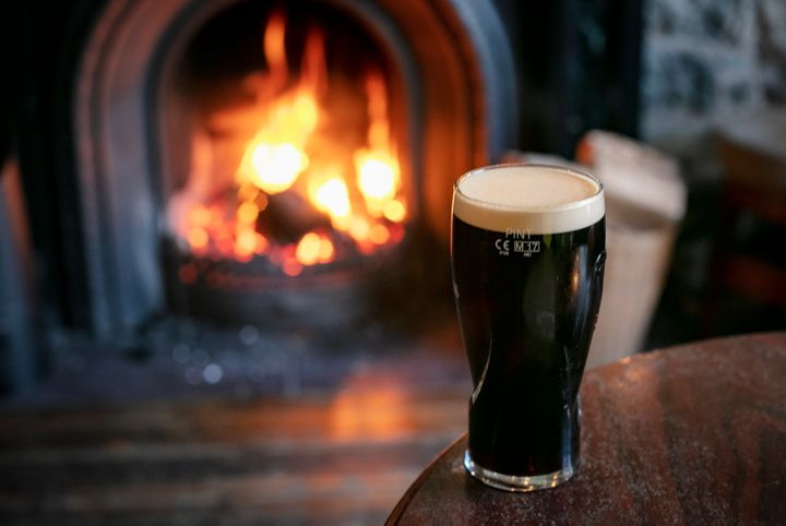 A pint of stout by a roaring fire.