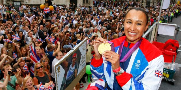 Britain's heptathlon Olympic gold medallist Jessica Ennis poses for a picture as her float passes the...