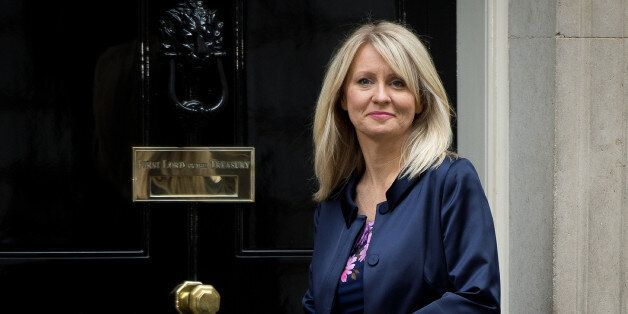Esther McVey poses for pictures outside 10 Downing Street in London, on October 7,