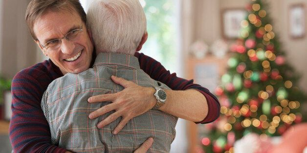 Smiling son hugging his dad at Christmas