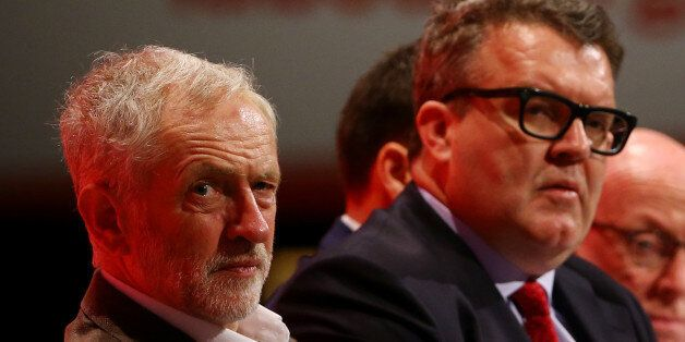 Labour party leader Jeremy Corbyn (left) with deputy leader Tom Watson listening to speeches onstage...
