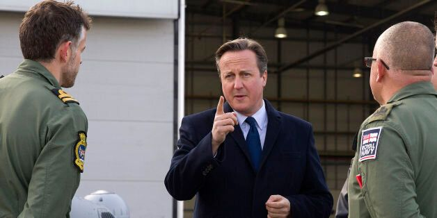 British Prime Minister David Cameron (centre) talks to Royal Navy personnel during his visit to Royal...
