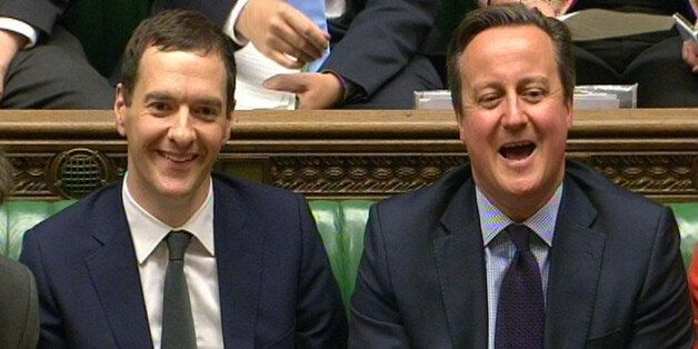 Chancellor of the Exchequer, George Osborne and Prime Minister David Cameron listens as shadow chancellor...