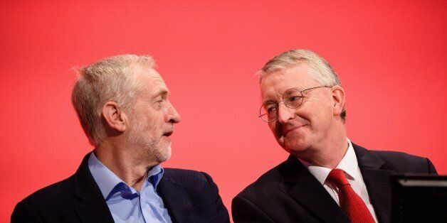 Leader of the opposition Labour Party Jeremy Corbyn (L) speaks with with Shadow Foreign Secretary Hilary...