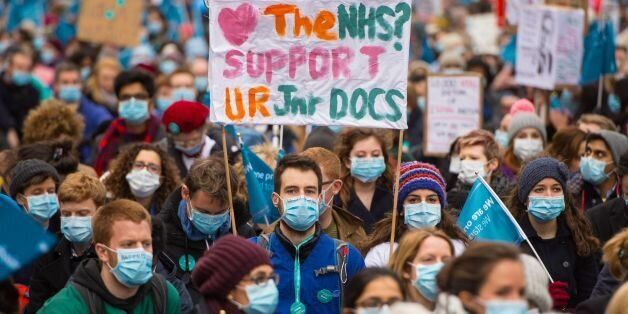 Junior doctors and their supporters stage sit-down protest outside Downing Street, in Westminster, London,...