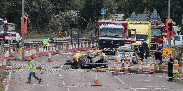 Emergency services attend the scene on the A27 as seven people have died after a plane crashed into cars...