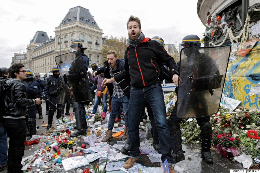 Banned Paris Climate March Turns Violent As Protesters Throw Memorial Candles At