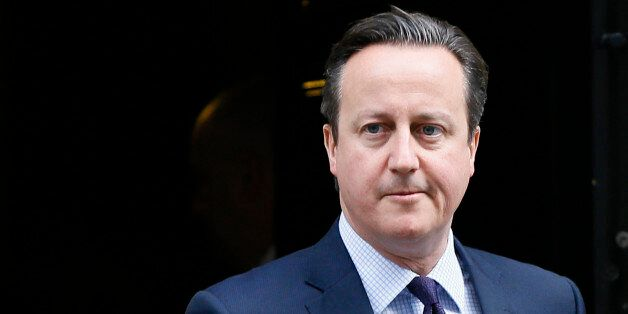 Britain's Prime Minister David Cameron leaves 10 Downing Street to attend Parliament in London, Thursday,...