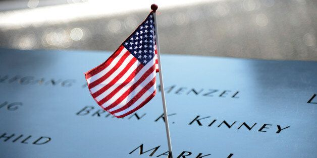 NEW YORK, NY - SEPTEMBER 11: A flag adorns the 9/11 Memorial on the twelfth anniversary of the terrorist...