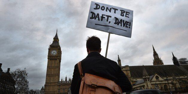 A lone protester opposed to British military action in Syria holds a placard reading 'Don't be daft,...