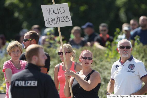 Angela Merkel Heckled And Booed By 'Shameful' Anti-Refugee Protesters In