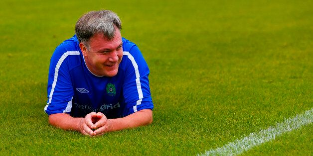 Ed Balls on the pitch after stumbling during the MPs vs lobby journalists football