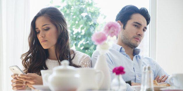 Couple arguing in restaurant