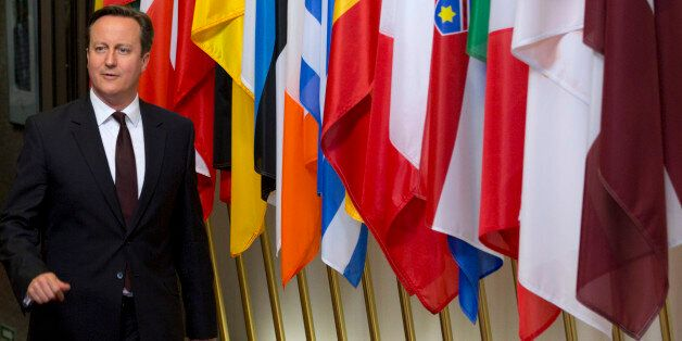 British Prime Minister David Cameron leaves after an EU summit in Brussels on Friday, June 26, 2015....