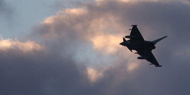 AKROTIRI, CYPRUS - DECEMBER 03: A RAF Typhoon arrives at RAF Akrotiri on December 3, 2015 in Akrotiri,...