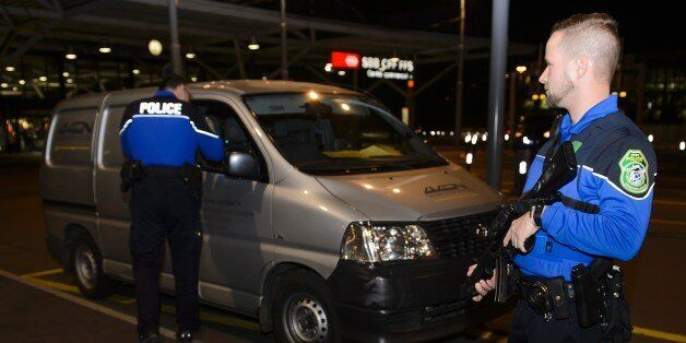 Security forces stop a van at the check vehicles arriving at Geneva's airoport on December 10, 2015,...