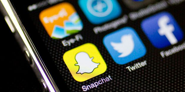The Snapchat Inc. application (app) is seen on an on an Apple Inc. iPhone 5s displayed for a photograph...