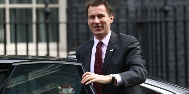 British Health Secretary Jeremy Hunt arrives at Downing Street in London on February 20 , 2016 for a...