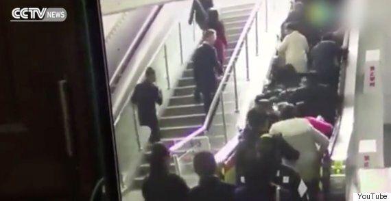 Chinese Escalator Switches Backwards Causing Huge Pile
