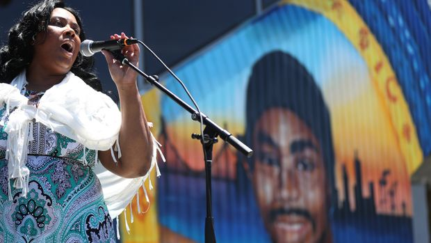 "OAKLAND, CALIFORNIA - JUNE 8: Wanda Johnson, mother of Oscar Grant, speaks before family and community members during the mural and street name rededication in honor of Oscar Grant outside the Fruitvale BART station in Oakland, Calif., on Saturday, June 8, 2019. Grant was unarmed and shot and killed by BART police officer Johannes Mehserle on New Year""u2019s Day 2009 in the BART station platform. (Photo by Ray Chavez/MediaNews Group/The Mercury News via Getty Images)"