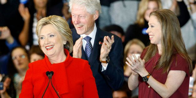 Democratic presidential candidate Hillary Clinton speaks in front of former President Bill Clinton and...