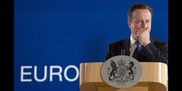 British Prime Minister David Cameron pauses before speaking during a final media conference after an...
