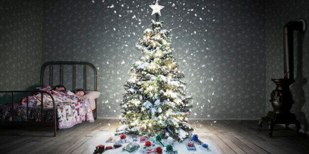A classic children's bedroom (vintage miniature) with a glowing decorated christmas tree with snow falling....