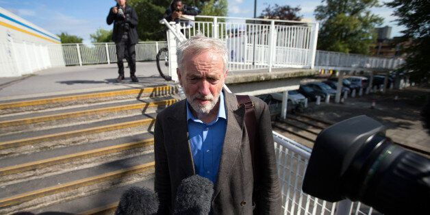 STEVENAGE, ENGLAND - AUGUST 25: Labour leadership candidate Jeremy Corbyn (L) speaks to the media as...