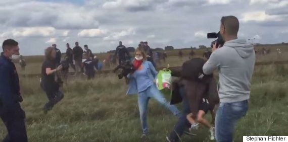 Hungarian TV Camerawoman Sacked After Video Shows Her 'Kicking A Refugee Carrying A